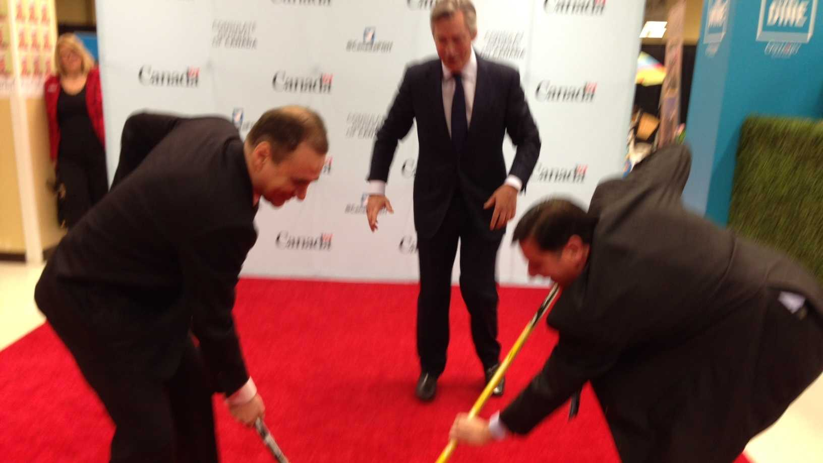 "No ribbon-cutting here: It's a face-off between Consul General John Prato and Mayor Bill Peduto to open ""Pop-Up Canada!"" in Pittsburgh. The puck was dropped by Gary Doer, Ambassador of Canada to the U.S."