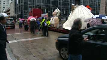 A 26-foot-tall, 36,000-pound statue of Marilyn Monroe brightened up PPG Plaza in downtown Pittsburgh on a rainy Monday.