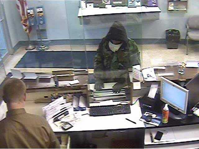 The city's Public Safety Department has posted these surveillance photos of Pittsburgh bank robberies that police believe were committed by the same man. This one is from Dec. 30, 2013, at First National Bank in Greenfield Avenue.