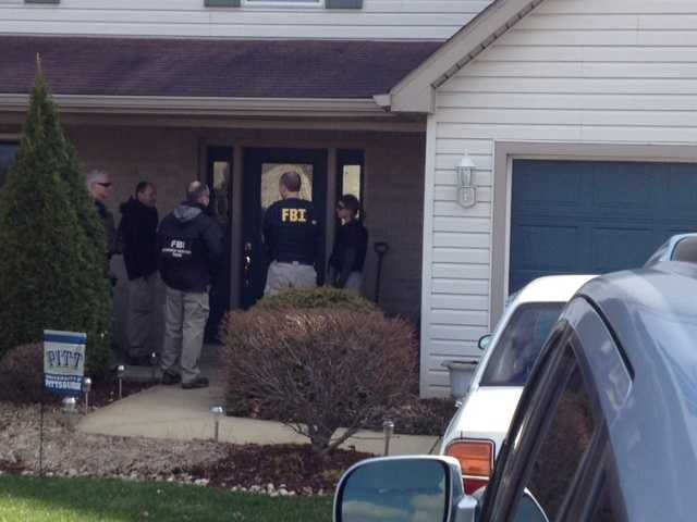 FBI agents spent about three hours searching the home of a 16-year-old sophomore charged with stabbing nearly two dozen people at Franklin Regional High School.