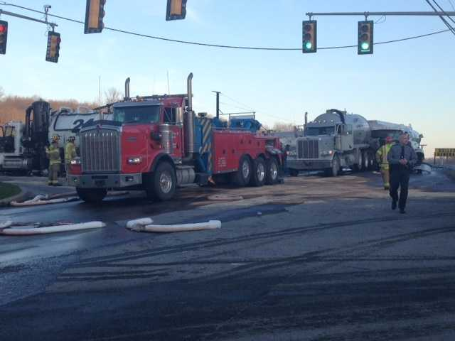 Hazmat and DEP teams responded to the accident scene on Henderson Avenue.