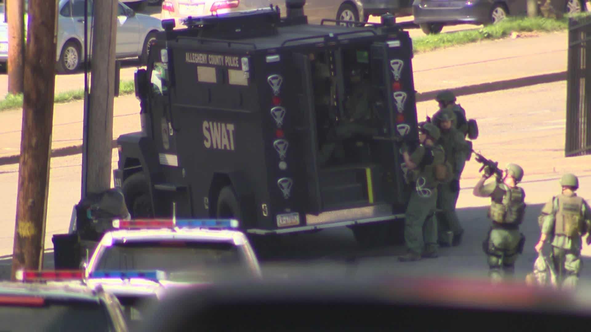SWAT guns pointed