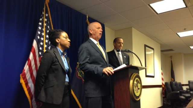 U.S. Attorney David Hickton speaks at a news conference with Akeia Conner, special agent in charge of IRS criminal investigations, and Patrick Fallon, FBI assistant special agent in charge.