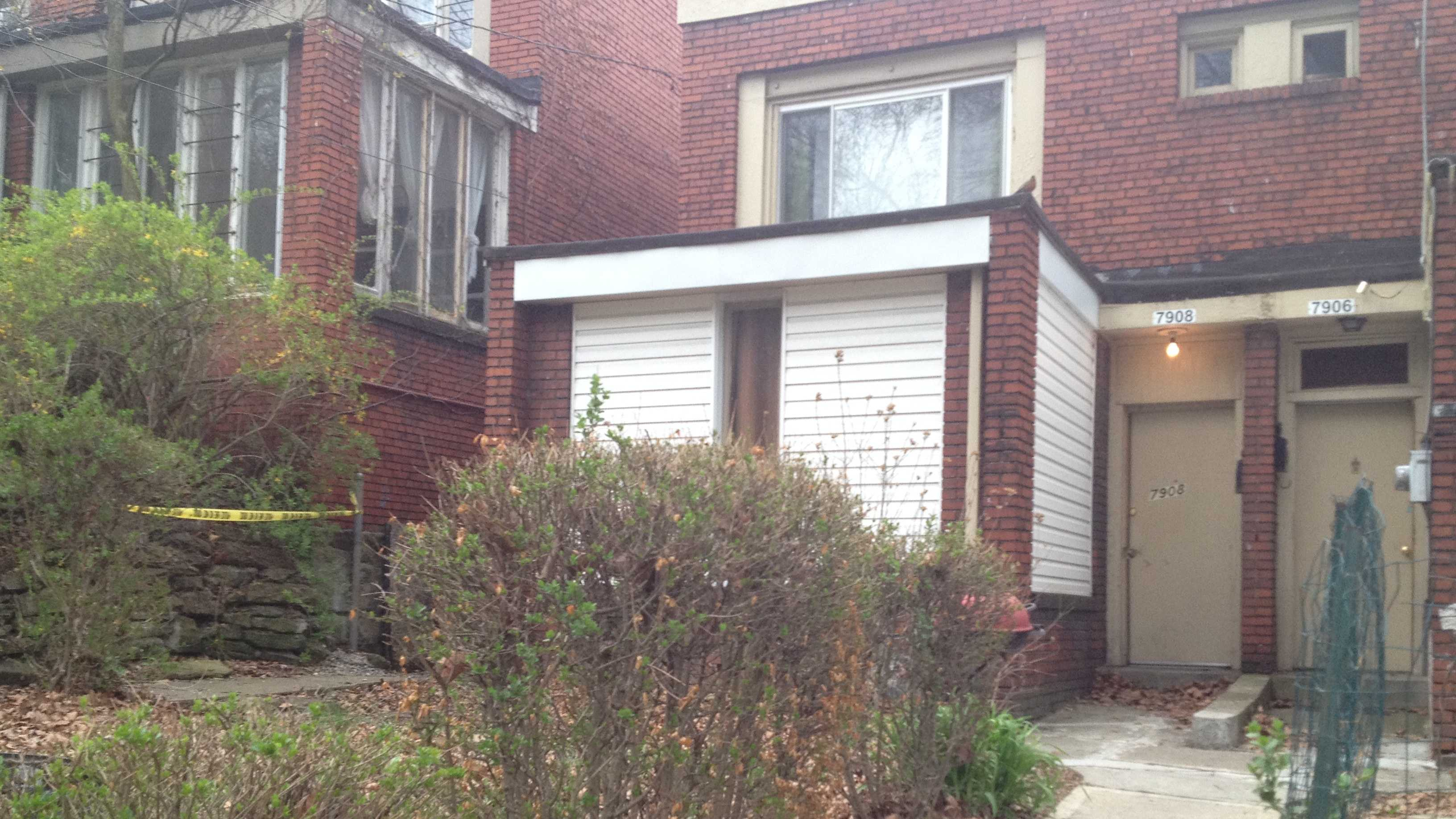 Pittsburgh police say the body of Kerrese Lawrence was found inside this house on Hamilton Avenue in Homewood.