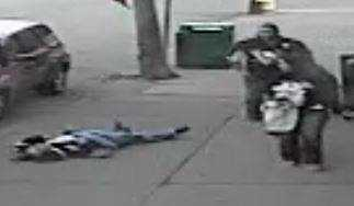 Surveillance video from March 22 outside Shale's Cafe on Fifth Avenue, across the street from Consol Energy Center, shows a person in a dark-blue Penguins jersey lying on the sidewalk and another fan in a No. 10 black Penguins jersey walking away with a woman.