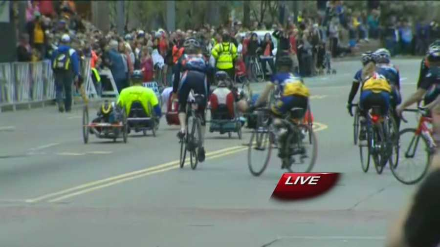 """Hand Cranked"" competitors took off from the finish line escorted by cyclists on the course."