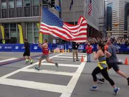 Team red white and blue approaching the finish