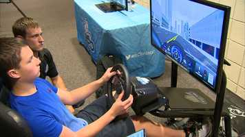 Students took the wheel of a simulator that demonstrated the consequences of texting while driving.