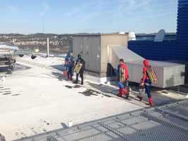 The superheroes went onto the roof and prepared to scale down the side of the building and wash the windows at Children's Hospital of Pittsburgh of UPMC on Tuesday morning.