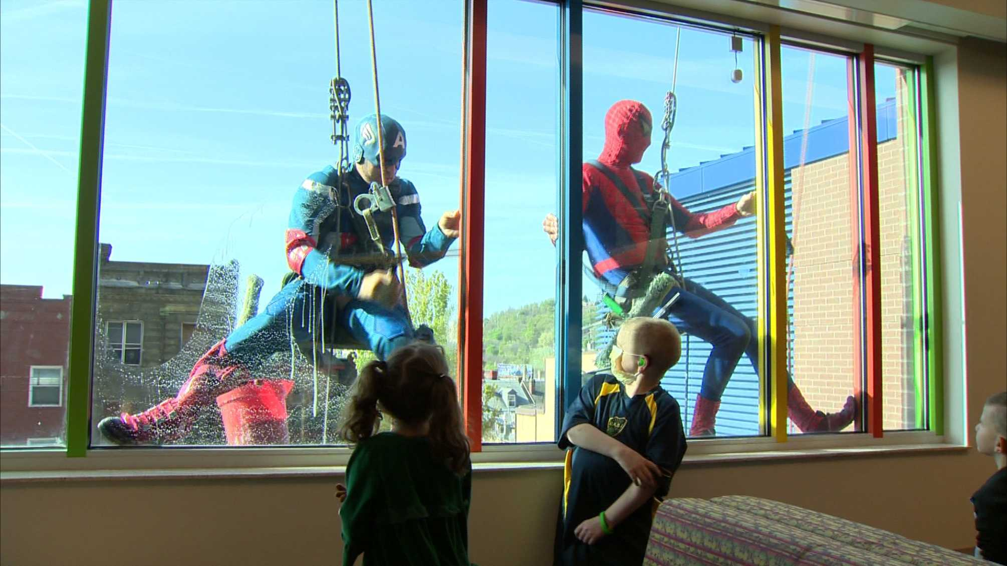 These kids found a great spot to watch the superheroes go to work.
