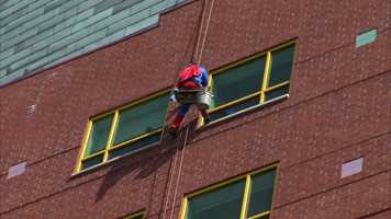 Superman washes the windows at Children's Hospital of Pittsburgh of UPMC.