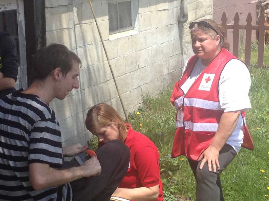 Workers from the American Red Cross talk to Brandon Richard after he escaped the house fire.