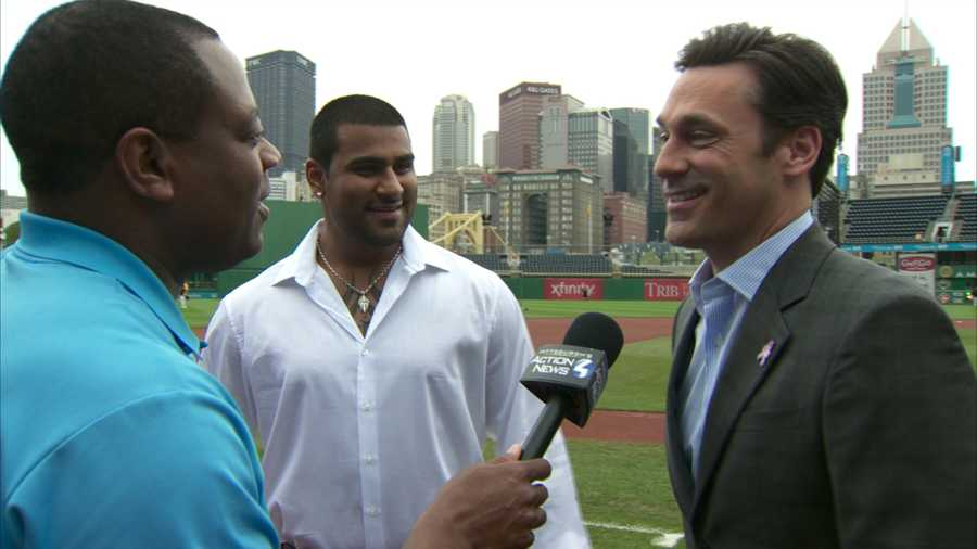 """""""Mad Men"""" actor Jon Hamm and minor league pitcher Rinku Singh -- the inspiration behind Hamm's new movie, """"Million Dollar Arm"""" -- visit PNC Park during a Pirates-Cardinals game."""