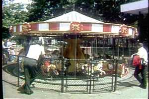 Riding the kiddie carousel in the 1960s.