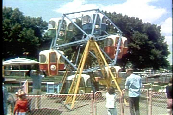 Riding the kiddie ferris wheel in the 1960s.