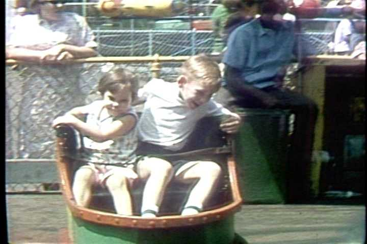Riding the kiddie whip at Kiddieland in the 1960s.