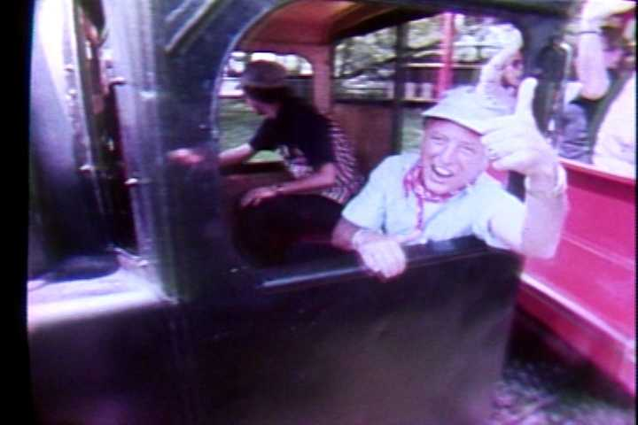 Myron Cope riding the Olde Kennywood Railroad in 1979.