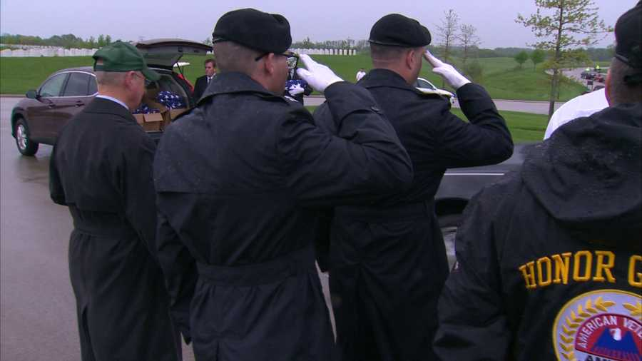 The color guard fired a 21-gun salute. Buglers played taps. And the ashes were placed in their final resting place at the veterans' cemetery. A crowd was gathered to honor the veterans being interred.