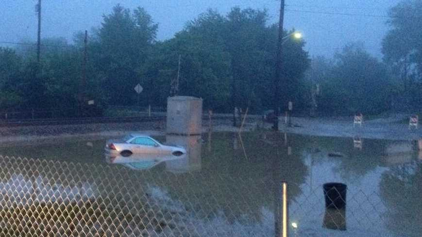 A Mercedes was stuck in flood waters on Third Avenue in Sutersville, Westmoreland County.
