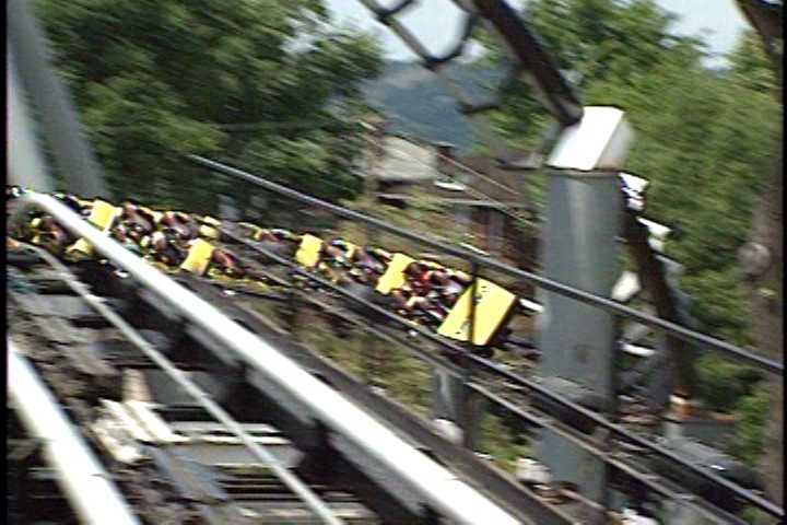 Cars had over-the-shoulder harnesses to keep riders locked in place as they traveled up, down and all around at high speeds.