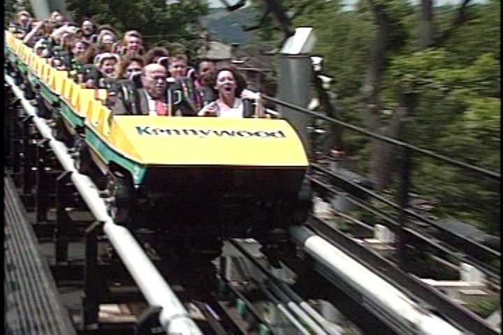Breathing a sigh of relief (or maybe a scream?) as the car approaches the platform and the ride comes to an end.