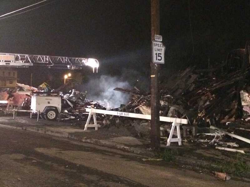 Firefighters returned to the scene in Mount Oliver as smoke continued to rise from the debris on Monday morning.
