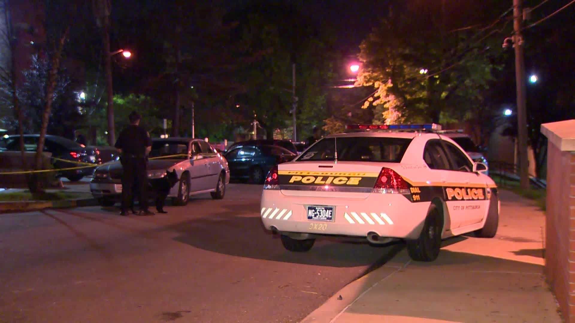 Pittsburgh police say gunfire wounded two men and a woman in a parking lot at Allegheny Dwellings.