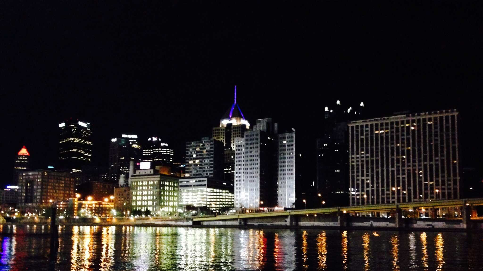 A view of the downtown skyline at night.