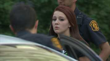 Ariel Lawther is put into a Pittsburgh police car and taken to jail.