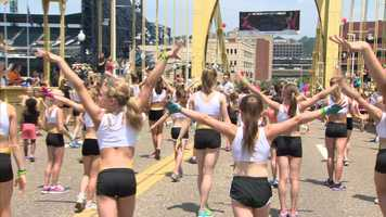 Girls from 14 local gymnastic clubs got together on the Roberto Clemente Bridge and crushed the previous world record of 482 simultaneous cartwheels.