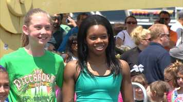 Olympics gold medalist Gabrielle Douglas helped the girls set the world record for most simultaneous cartwheels.