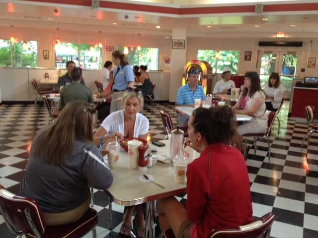 Some of the first customers at Kennywood's new Johnny Rockets restaurant sit down for lunch.