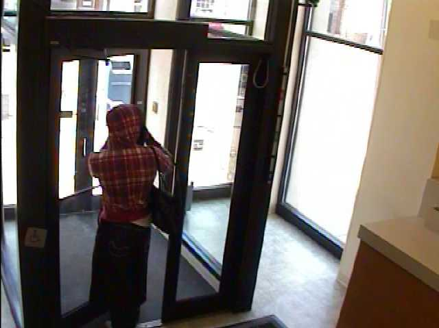 Surveillance image of a person who robbed Huntington Bank on Brownsville Road in Carrick.