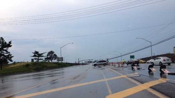 Utility poles and wires fell on Route 228 in Cranberry Township during a severe storm Tuesday.