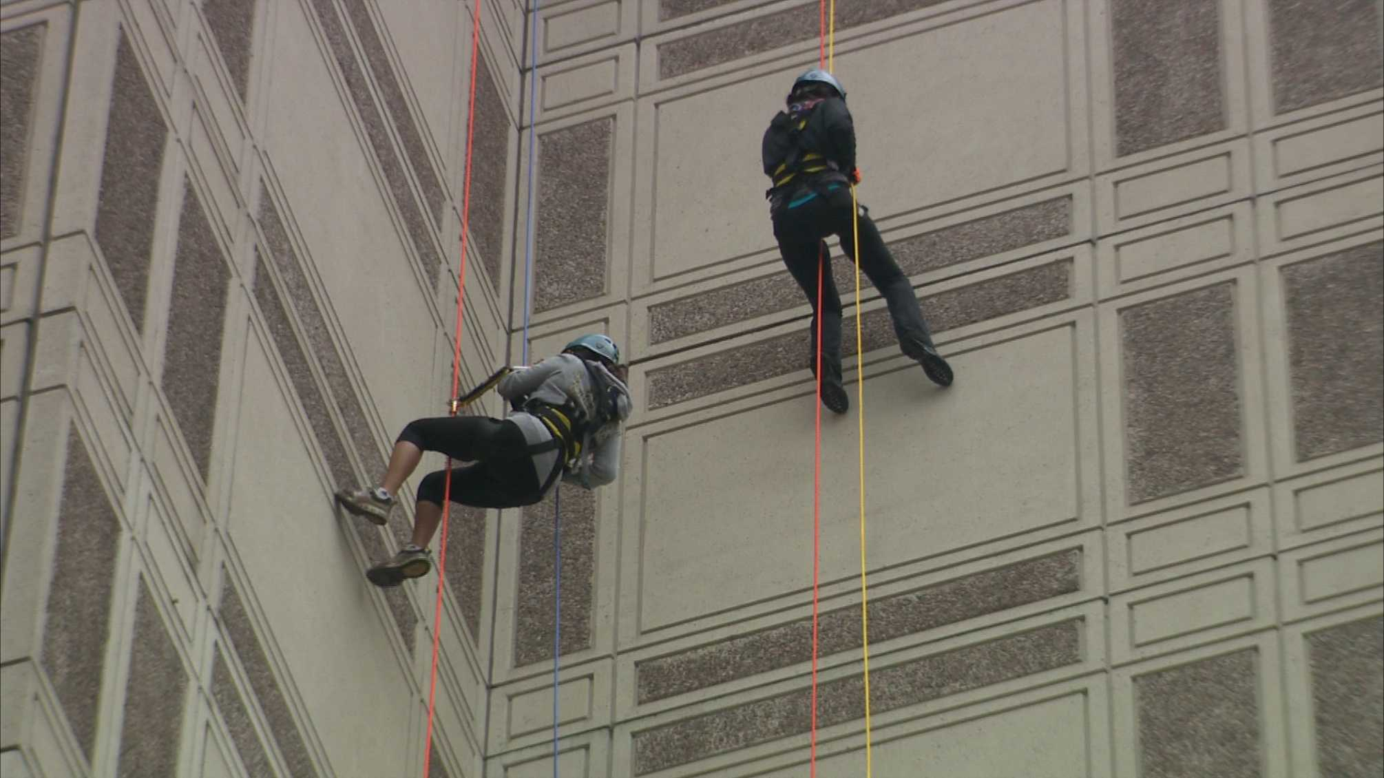 Nearly 100 people scaled down the side of the Westin Convention Center hotel in downtown Pittsburgh to raise awareness and funds for Shatterproof, an organization that helps fight addiction.