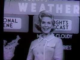 Eleanor Schano, reading the latest weather forecast.