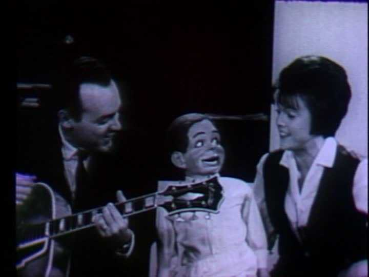 """In this picture, Joe Negri and Sandy Mason sing """"Old MacDonald Had a Farm"""" with Tommy the ventriloquist doll."""