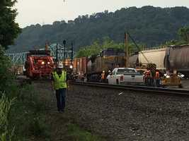 Norfolk Southern crews continue their cleanup work after a train derailment in Sewickley.