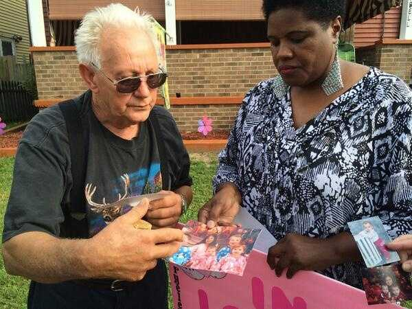 """During the vigil, the sisters' greatgrandfather shared pictures of the girls and called them his """"light"""