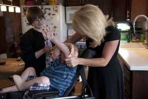 Kelly Frey gets Bennett ready for his first day of school.