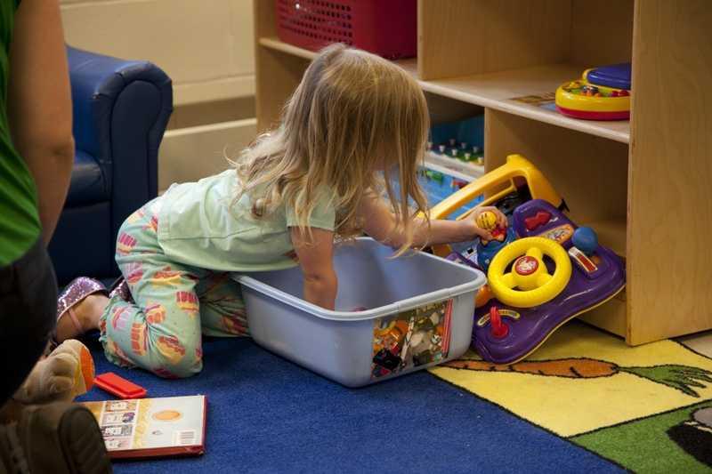 Marena explores her brother's classroom too.