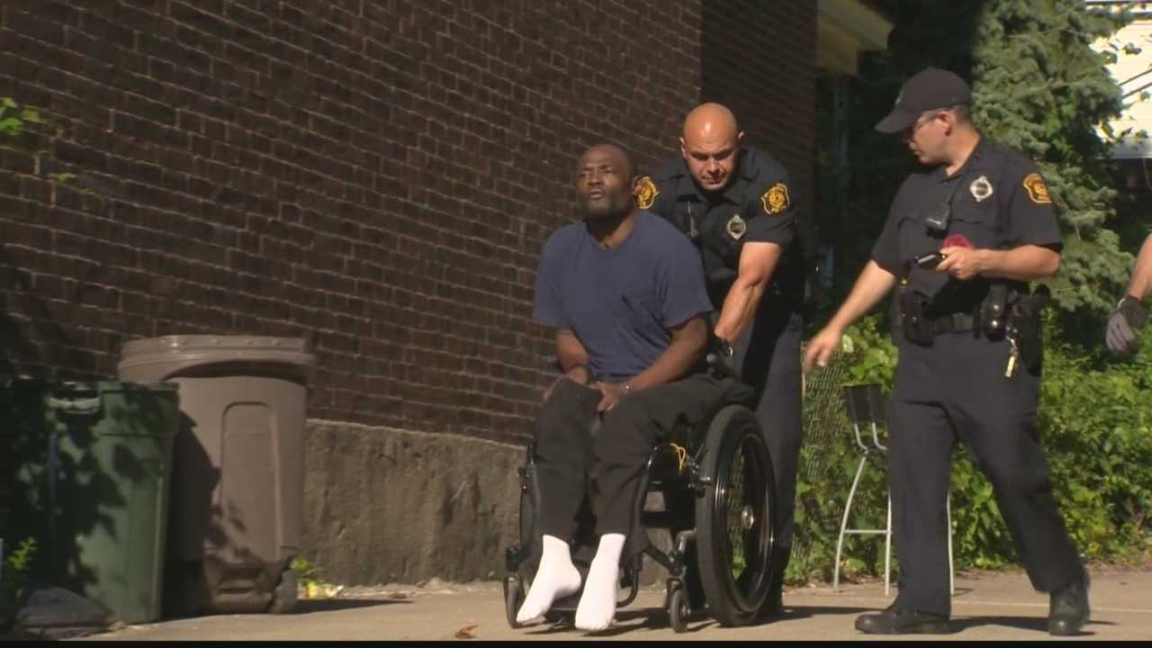 A man in a wheelchair is taken into custody after a woman is stabbed Wednesday afternoon in Oakland.