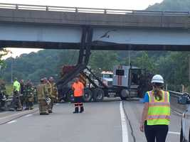 The ramp from Route 65 to Interstate 79 South was closed after a truck hit an overpass Friday morning.