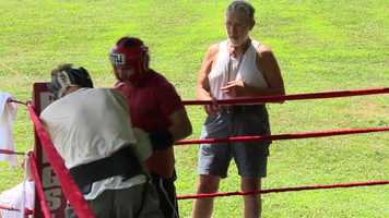Buzz Garnic watches Rod Salka in a sparring session at his training camp.
