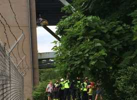 Rescue crews below the bridge where the trapped child is located