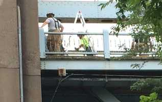 Rescue crews up on the bridge above the trapped child