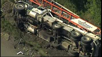 The driver was trapped when the truck flipped over.