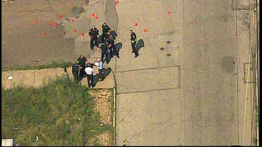 At least 13 evidence markers were seen on the ground.