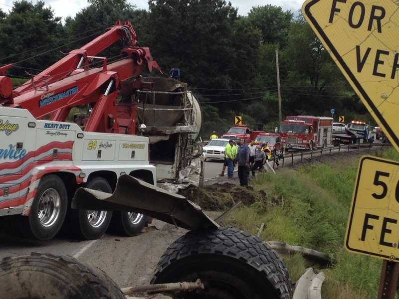 Middlesex fire officials said the tri-axle truck was behind a car as they were both heading east, and the car was getting ready to turn left onto Davis Road when it saw the cement mixer coming around the bend heading westbound.