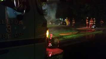 A woman was burned in the fire on Pleasant Avenue after propane tanks exploded.